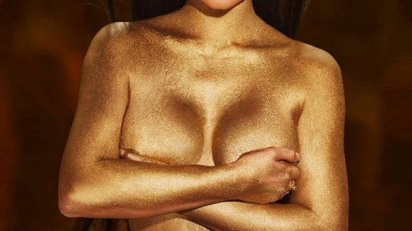 Kylie Jenner goes nude, covers herself in gold dust as she launches her 24k cosmetic collection